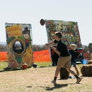 Two Boys Playing Lawn Games at Pumpkin Festival