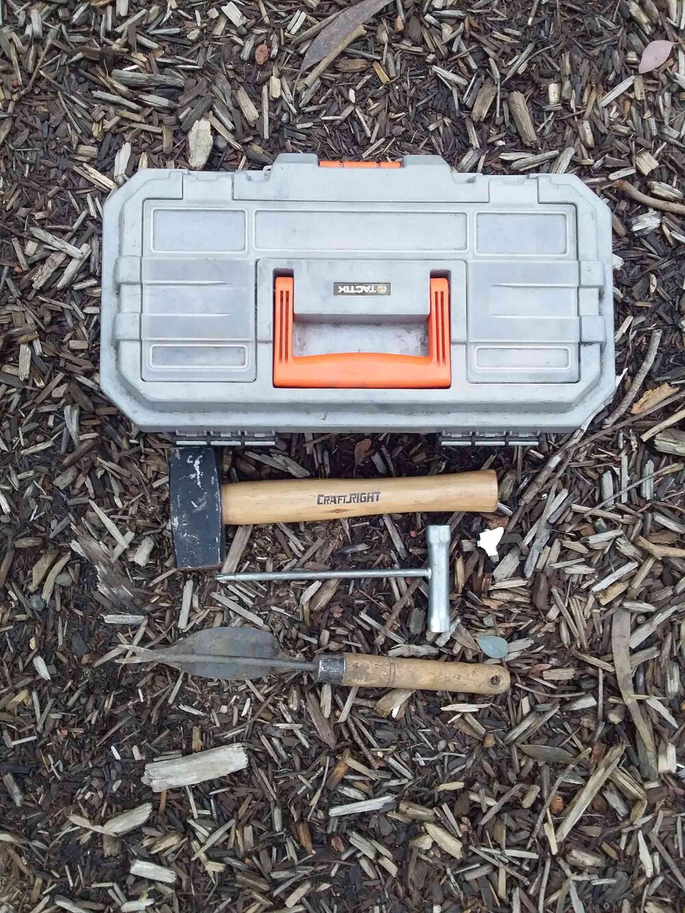A small toolbox fits in the back of the ute, along with a mallet, a scrench and a hand-weeding tool.