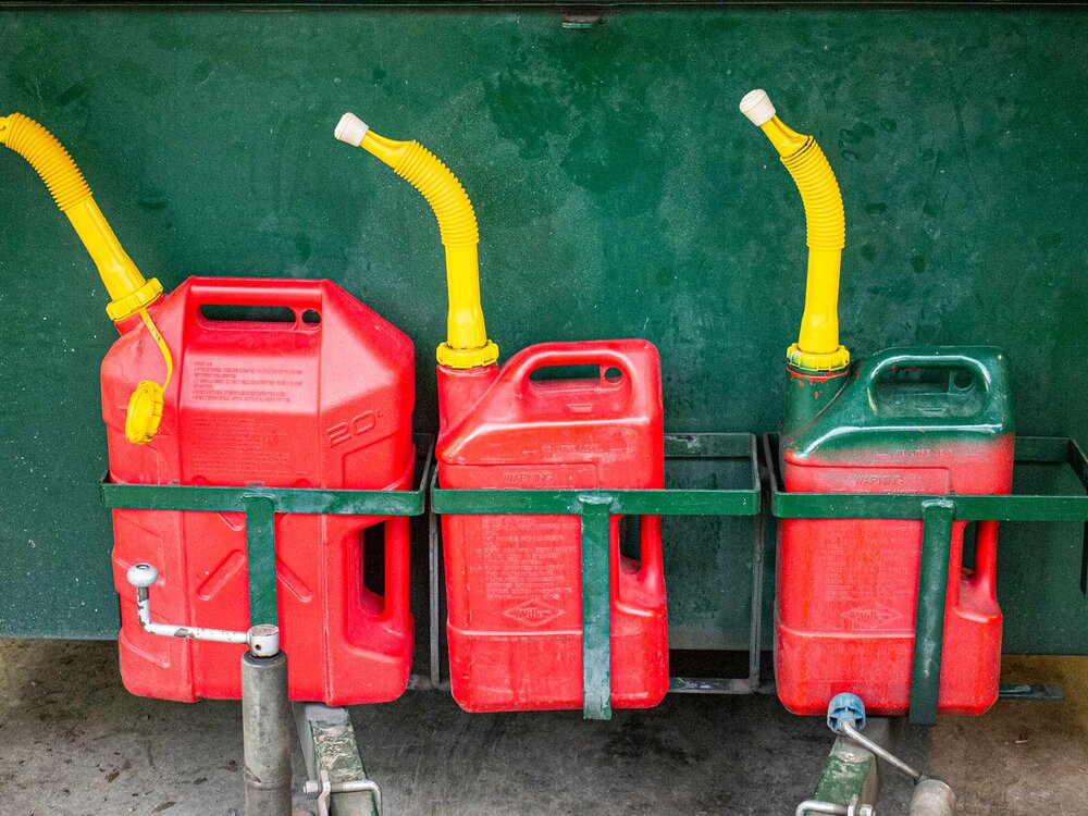 The jerry can painted green here is differentiated as the 2 stroke jerry can. Image via Plants Grow Here.