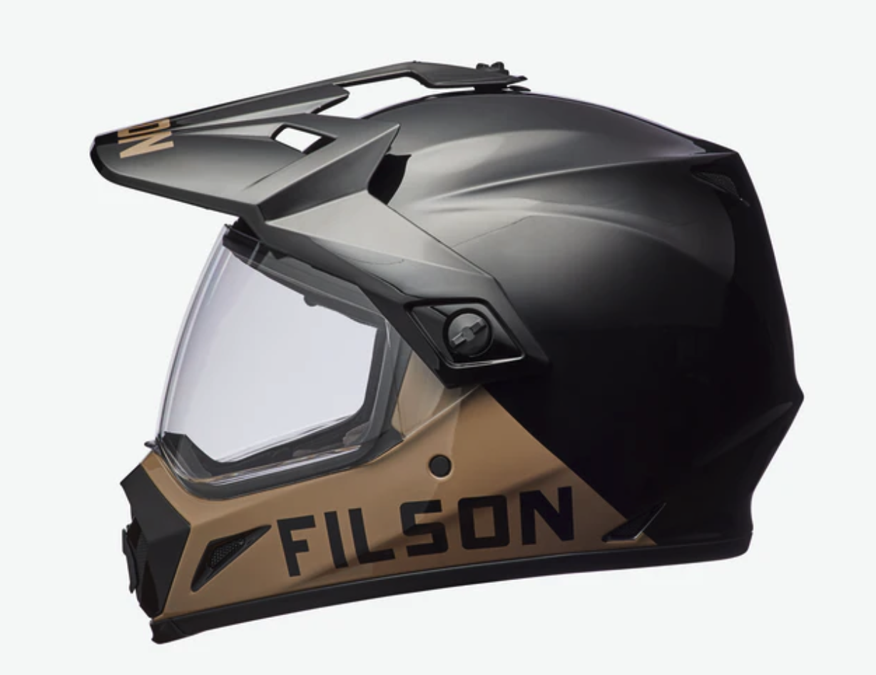 Filson's Bell MX-9 Adventure Motorcycle Helmet is designed to protect your head in the dangerous dual-sport activities of backcountry motorcycling. This helmet is designed to be extremely comfortable while riding and even when you are not. This helmet comes with a tough, but lightweight polycarbonate shell. It has a scratch-resistant, anti-fog visor that you can remove, or adjust. The visor comes with airflow vents to be sure that you are comfortable and can see the road ahead of you. Built by Bell, one of the first leaders in motorcycle helmets, Filson's Adventure Motorcycle Helmet is a safe choice and will make you look great while enjoying your dual sport. - The Filson helmet is selling for $265, which is a great price for something so important to the sport.