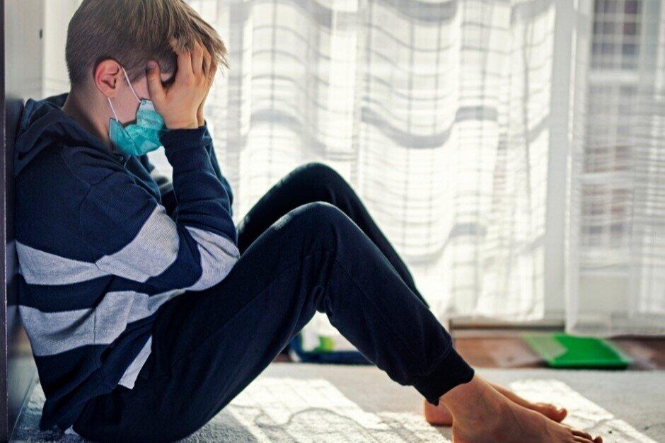 depressed-kid-during-epidemic-quarantine-picture-id1214716233.jpg