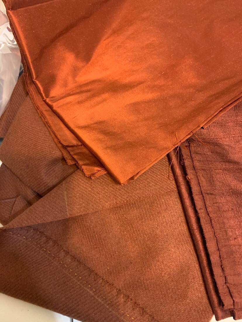 the gingerbread silk on the right might have looked nice, too, but the brandy (deep orange) really pops against the wool. taffeta is smoother and easier to work with than dupioni, too.
