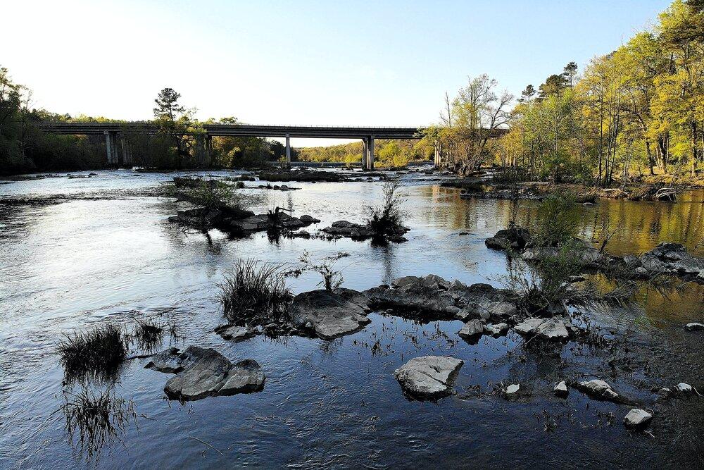 Jillian Howell, Pamlico-Tar Riverkeeper, collects the first round of microplastics sampling at Jack's Creek, NC.