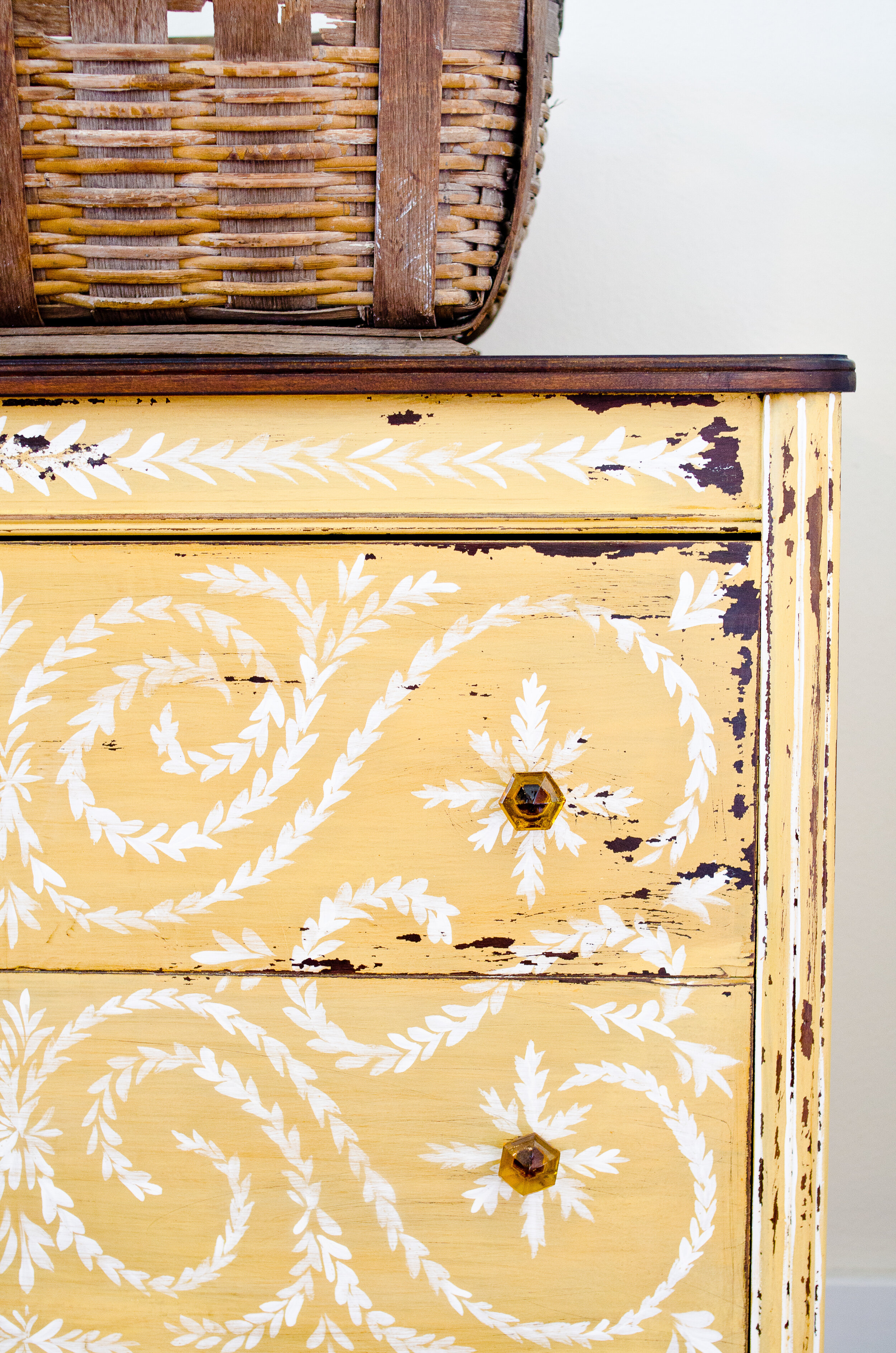 Chippy antique dresser painted in Mustard Seed Yellow Milk Paint with hand-painted floral design