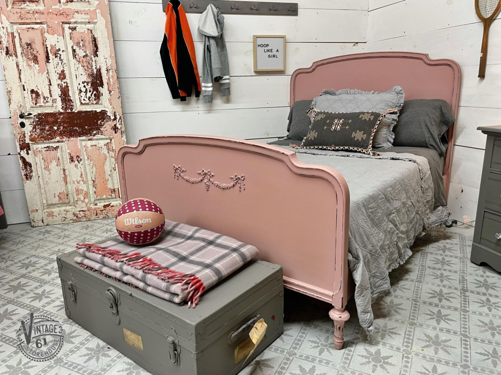 Chippy antique door, depression era bed in Arabesque by MMS Milk Paint, chest of drawers and foot locker painted in Trophy by MMS Milk Paint, stenciled floor, pink and gray bedroom