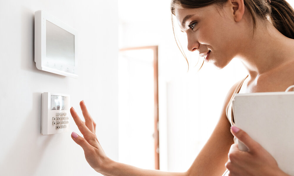 woman-using-home-security-system.jpg