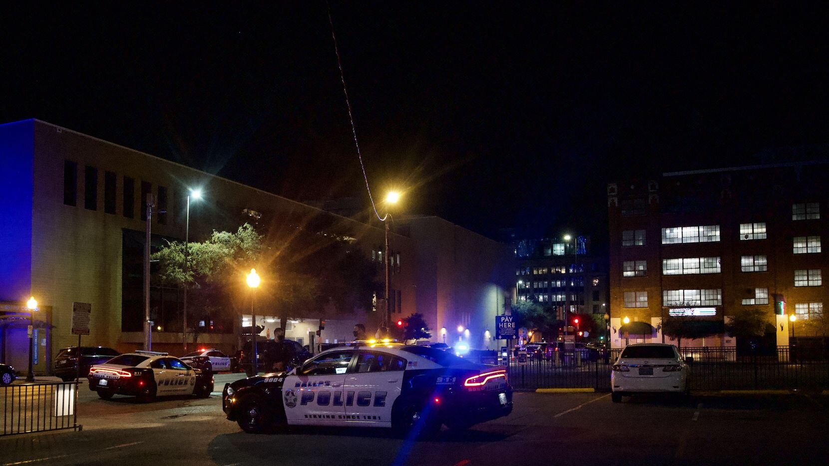 Police secure the area near the West End District in Dallas where a suspect engaged in gunfire with an El Centro officer Nov. 5.(Lynda M. Gonzalez / Staff Photographer Dallas Morning News)