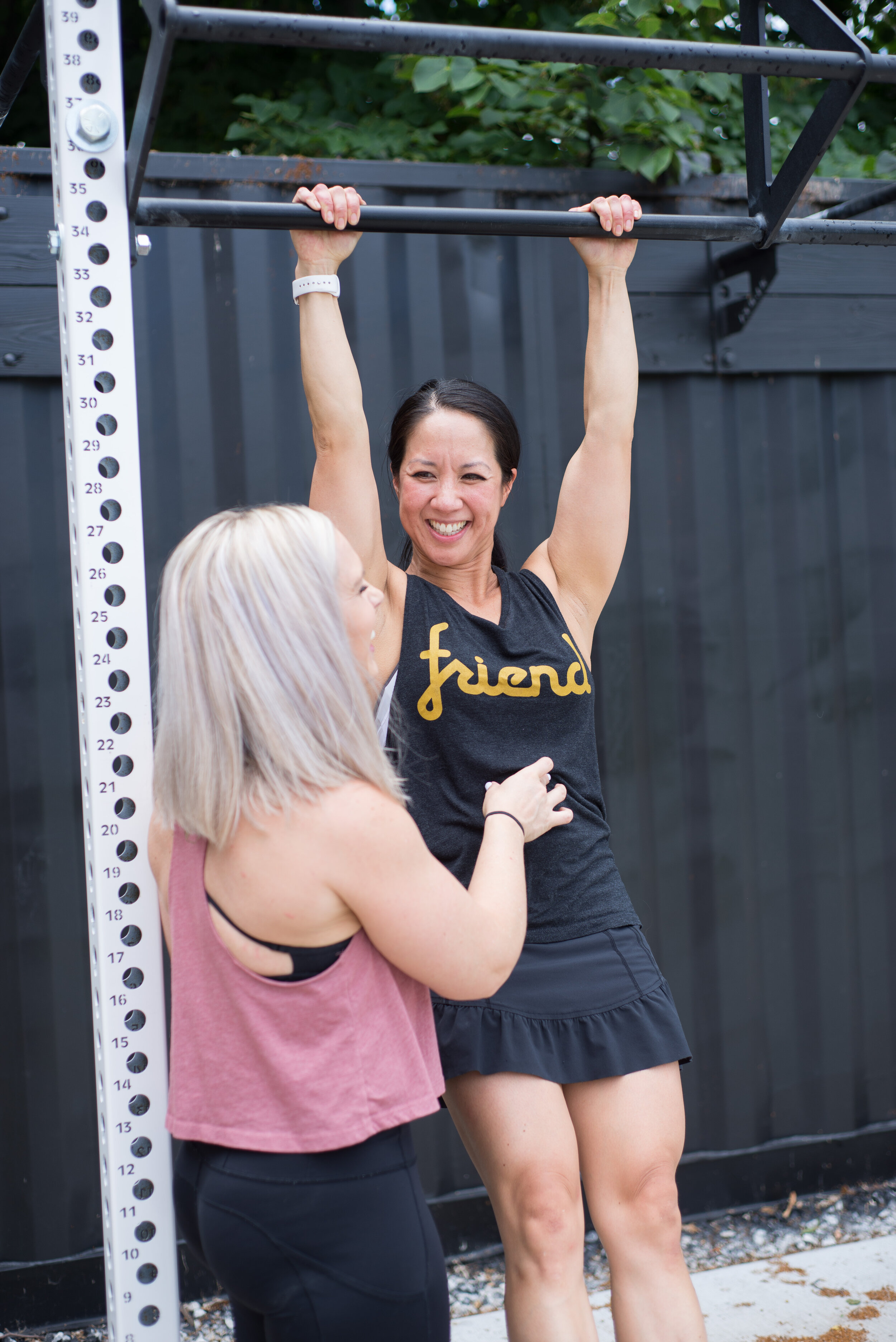 Coach Jenny Borda does Personal Training with Shelly working on her Pull-ups at our Outdoor Workout Gym in Dublin, Ohio