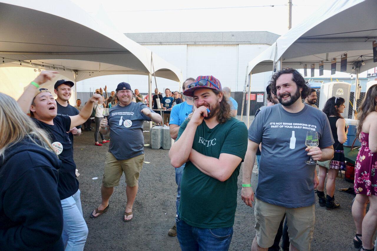 Oakshire Brewing's Dan Russo (center)