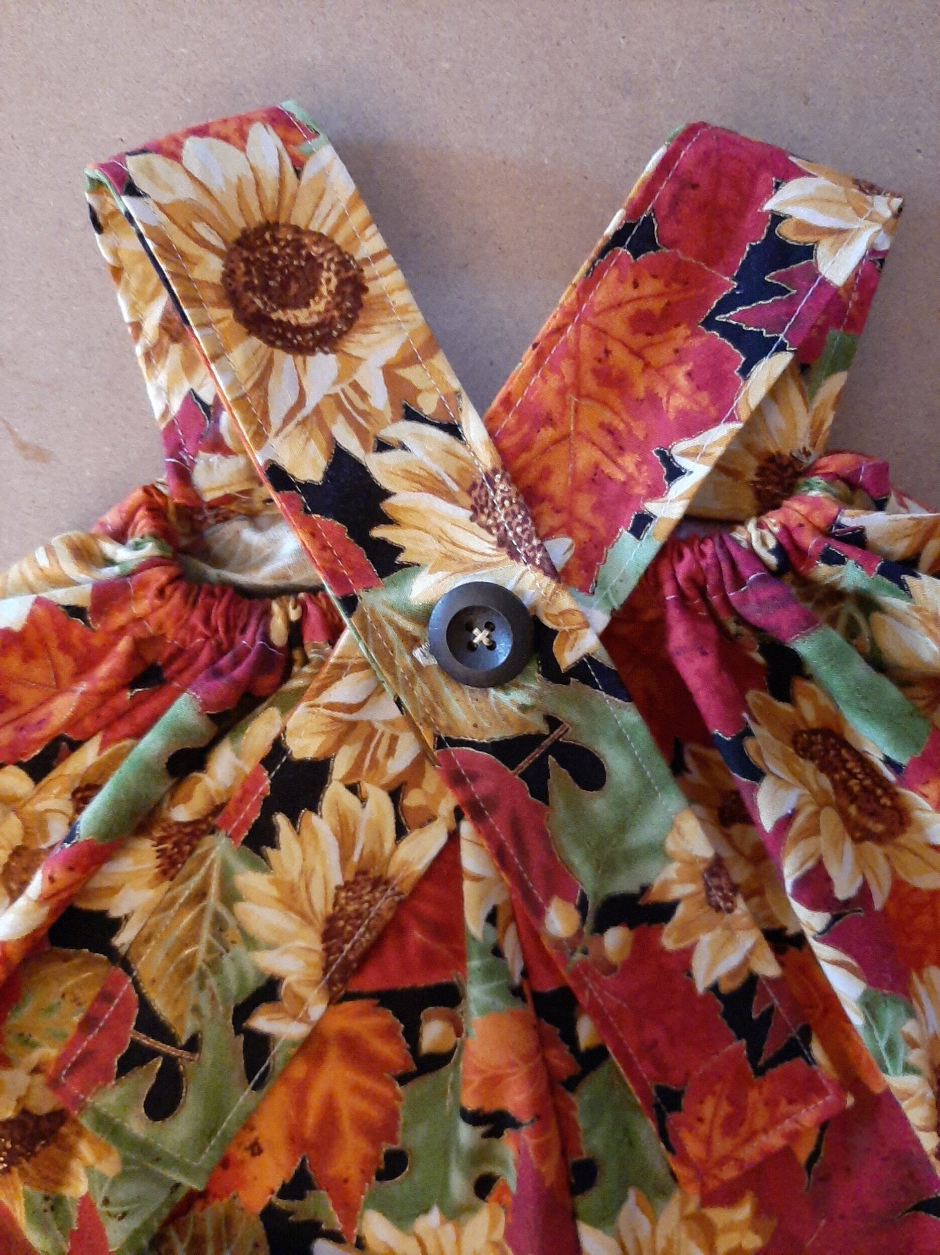 Button sew onto the center of the back.
