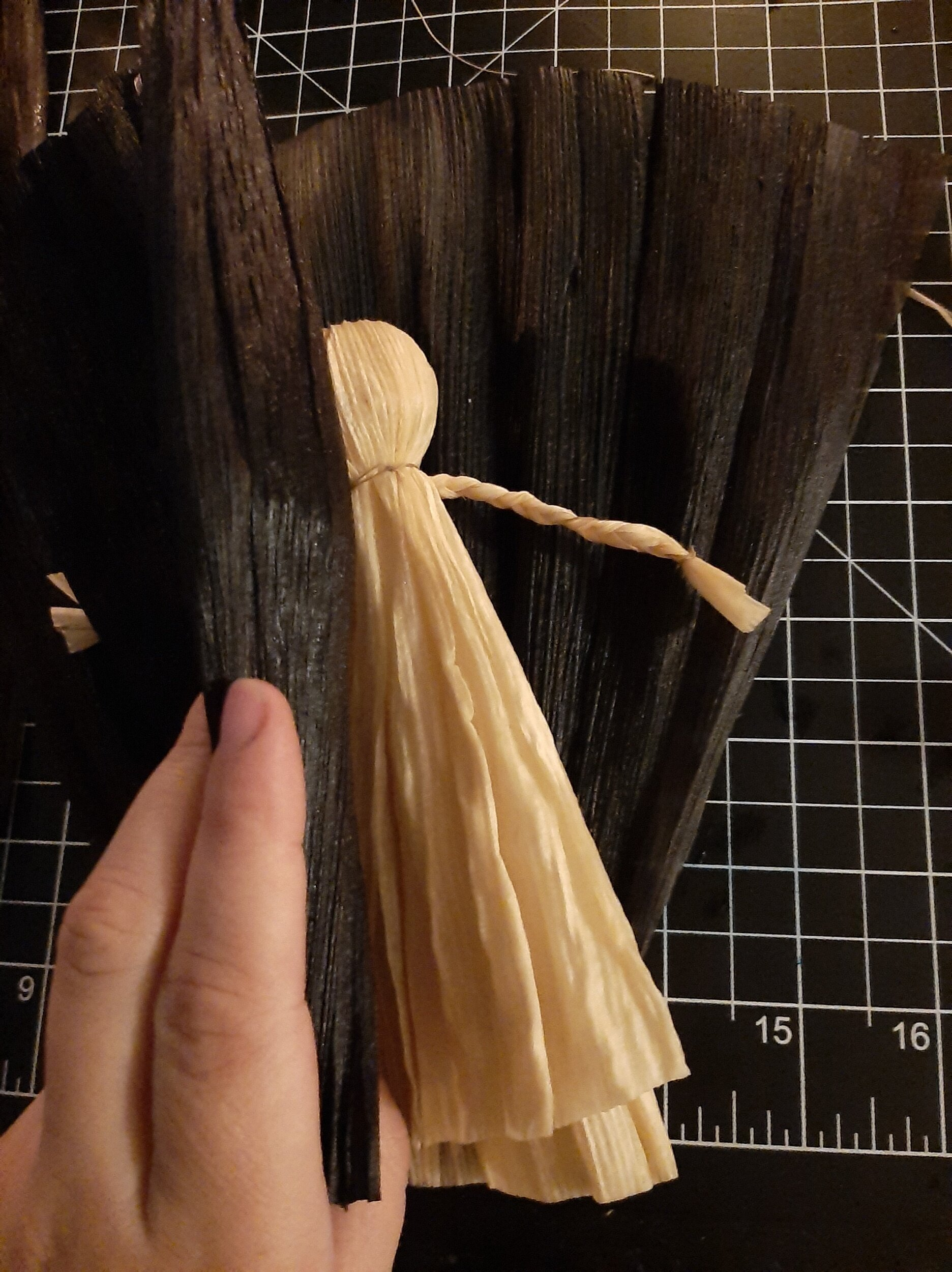 Placing my black husks top lined up with the bottom of my doll