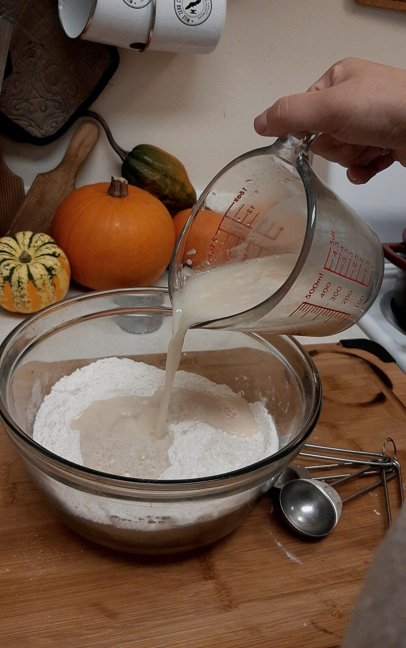 Add yeast mixture to flour.