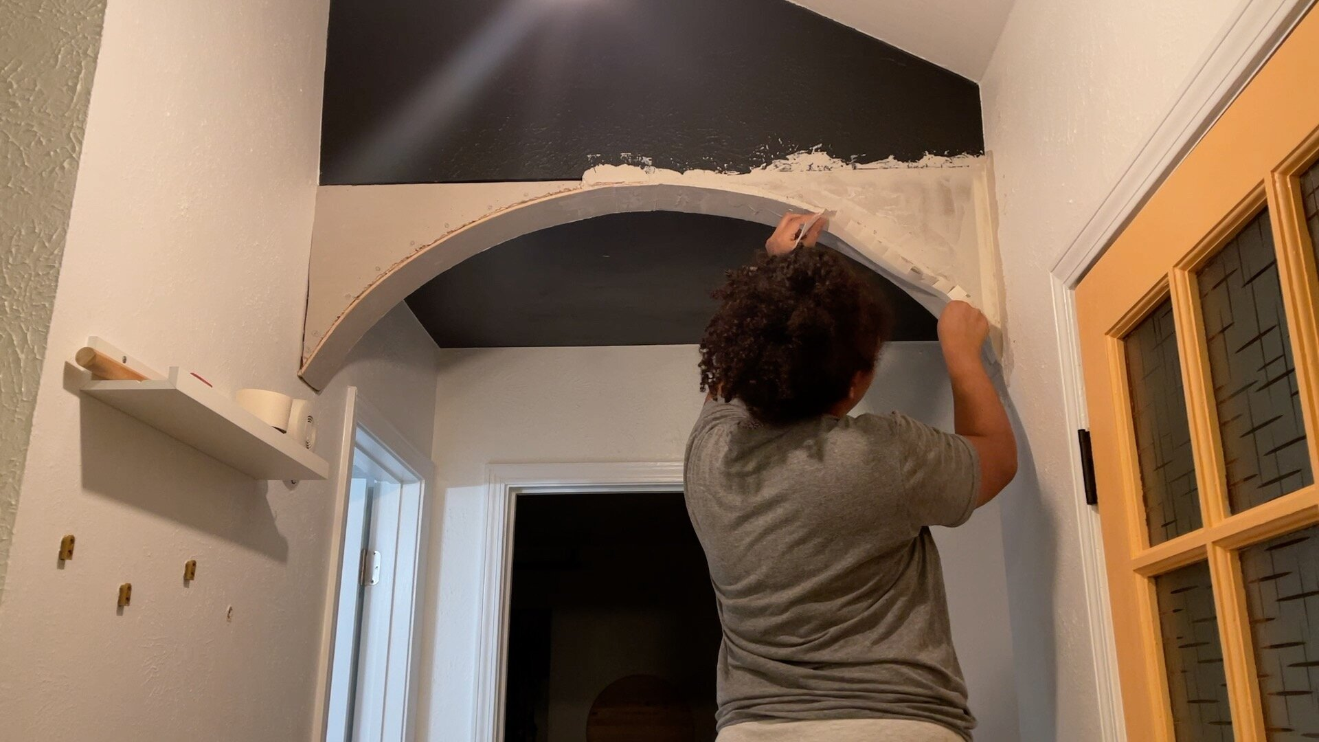 Applying the tape on the sides of the archway.