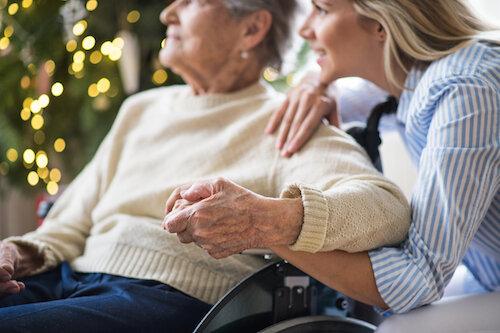 Daughter-sitting-next-to-elderly-mother-in-wheelchair-.jpeg