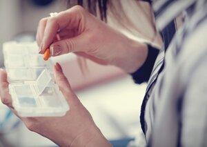 Hands arranging pills.jpg