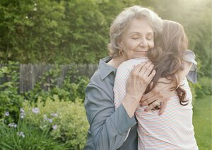 Elderly lady and young lady hugging.jpg