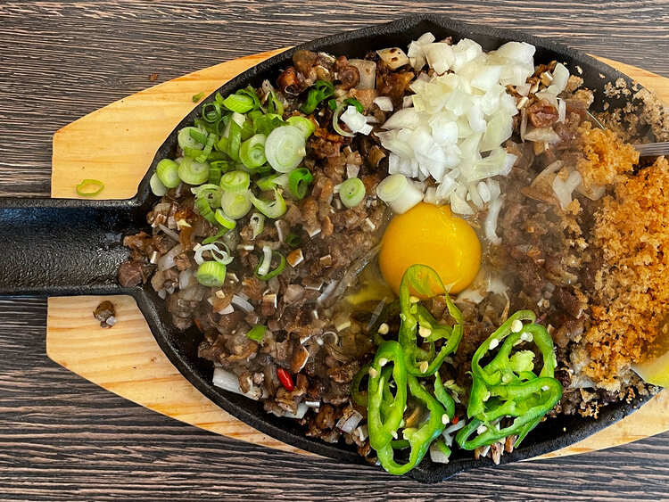 Finally, the sizzling sisig made its way to my table and I could have not been happier to see my old friend. The chicharron gave the dish a nice crunch and I'm always happy when restaurants prepare this dish the traditional way using pork jowl, ears and liver.