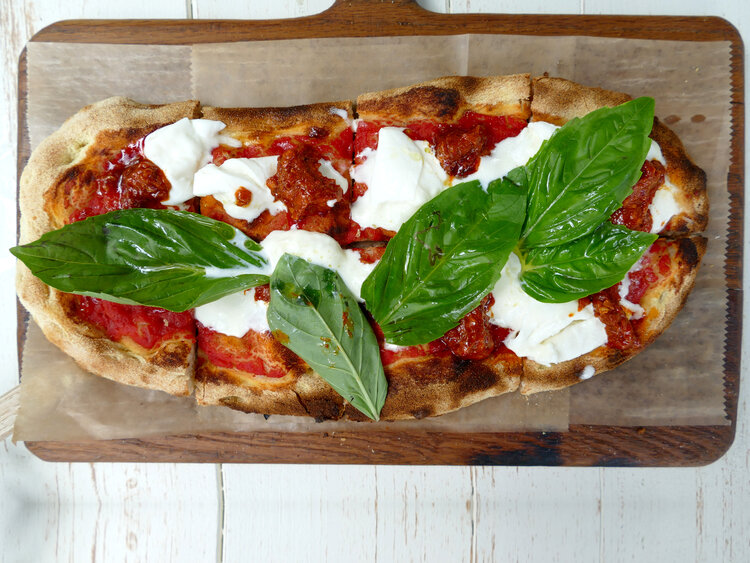 """Our second pinsa was """"Monica"""" which had San Marzano tomatoes, Nduja spicy salami spread with Stracciatella and basil. This pinsa was equally as good as the first and the spiciness of the Nduja was balanced with the richness of the Stracciatella and the fresh basil."""