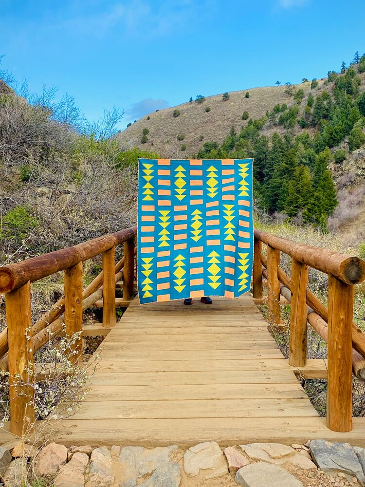 A bright quilt in the wild