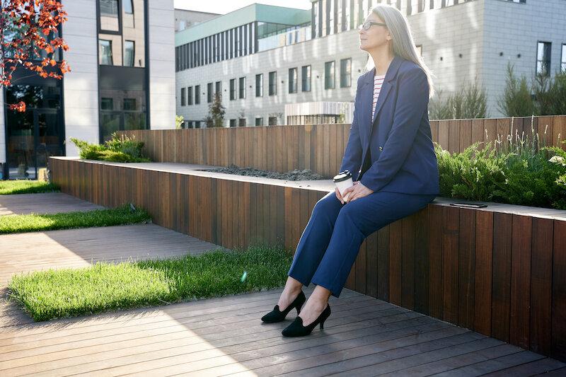 Executive woman taking break outside.jpeg